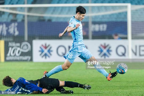 Gamba Osaka Forward Takagi Akito trips up with Jiangsu FC Defender Zhou Yun during the AFC Champions League 2017 Group H match between Jiangsu FC vs...