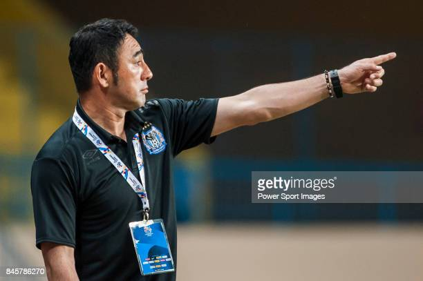 Gamba Osaka head coach Hasegawa Kenta gestures during the 2015 AFC Champions League Group Stage F match between Guangzhou RF and Gamba Osaka on April...