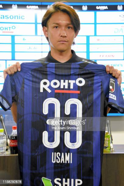 Gamba Osaka new player Takashi Usami poses for photographs during the press conference on June 25, 2019 in Suita, Osaka, Japan.