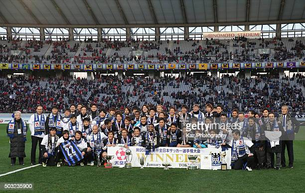 Gamba Osaka players and staffs pose for photographs after winning the 95th Emperor's Cup final between Urawa Red Diamonds and Gamba Osaka at...