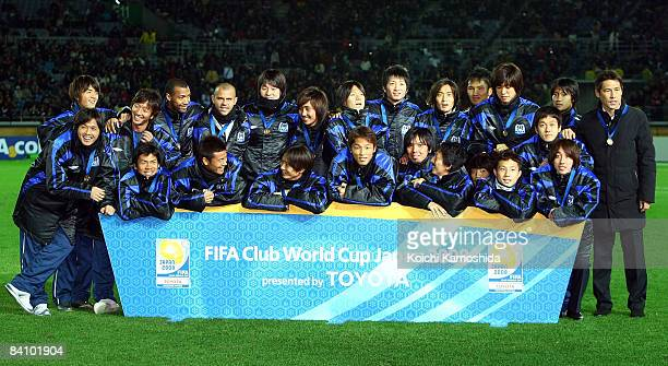 Gamba Osaka players pose for photographs after winning the FIFA Club World Cup Japan 2008 third place match between Pachuca and Gamba Osaka at the...