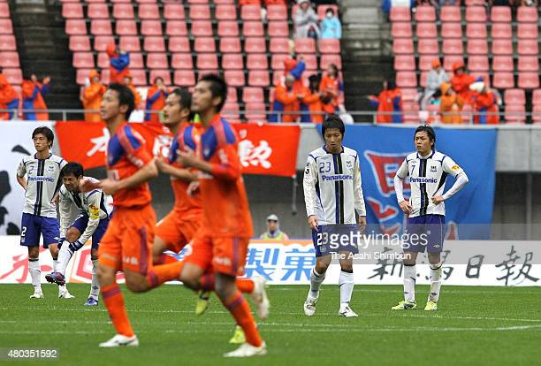 Gamba Osaka players react after conceding the first goal during the JLeague match between Albirex Niigata and Gamba Osaka at Big Swan Stadium on...