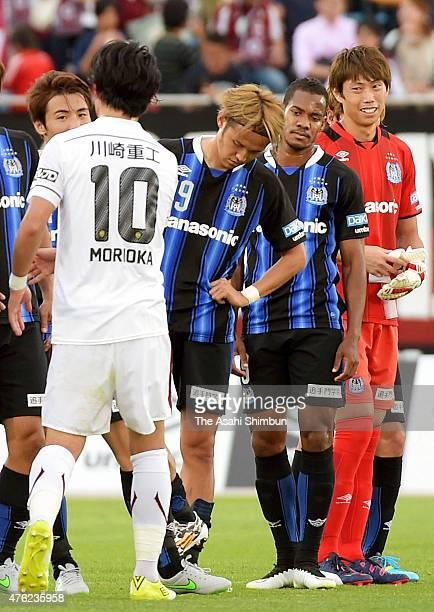 Gamba Osaka players react after their scoreless draw in the JLeague match between Gamba Osaka and Vissel Kobe at Expo '70 Commemorative Stadium on...