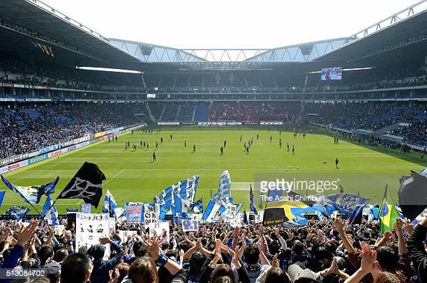 Gamba Osaka supporters cheer at the newly opened stadium during the JLeague match between Gamba Osaka and Kashima Antlers at the Suita City Football...