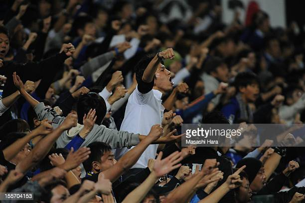 Gamba Osaka supporters cheer during the JLeague match between Kashiwa Reysol and Gamba Osaka at Hitachi Kashiwa Soccer Stadium on November 7 2012 in...