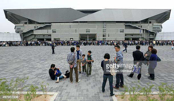 Gamba Osaka supporters who made the donation gather at the new stadium on October 10 2015 in Suita Osaka Japan