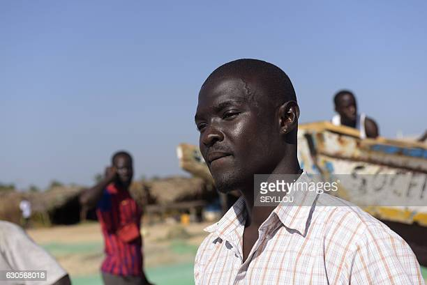 Gambian Ansu Sanyang poses next to a dugout on the beach in the village of Sanyang on December 4 2016 Ansu Sanyang was ready Sick of providing so...