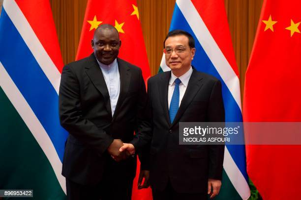 Gambian President Adama Barrow and China's Premier Li Keqiang shake hands at the Great Hall of the People in Beijing on December 22 2017 / AFP PHOTO...