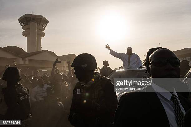 Gambian President Adama Barrow is surrounded by military police as he arrives at Banjul International Airport on January 26 2017 in Banjul The Gambia...