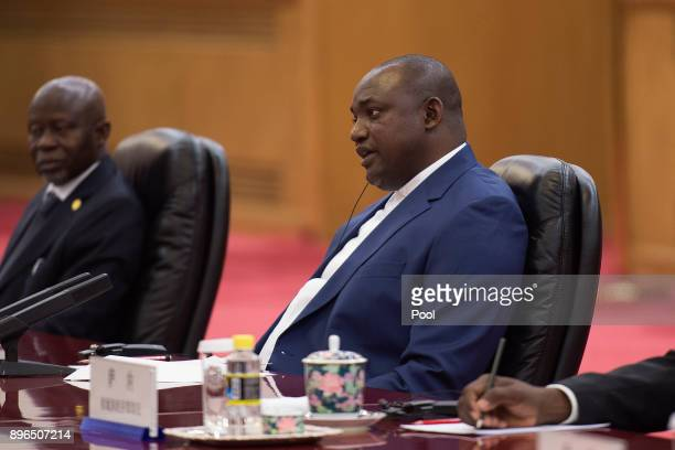 Gambian President Adama Barrow speaks to Chinese President Xi Jinping during a bilateral meeting at the Great Hall of the People on December 21 2017...