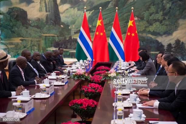 Gambian President Adama Barrow talks with China's Premier Li Keqiang during a meeting at the Great Hall of the People on December 22 2017 in Beijing...