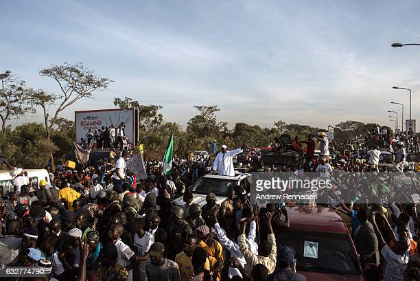 Gambian President Adama Barrow waves to his supporters as he arrives at Banjul International Airport on January 26 2017 in Banjul The Gambia Barrow...
