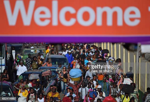 Gambian residents return to Banjul by ferry after fleeing political instability on January 22 2017 as Senegalese ECOWAS soldiers arrived to secure...