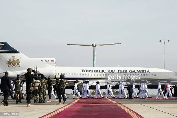 Gambian soldiers march during an official parade held for Gambia's president Adama Barrow at Banjul International Airport aftermath of his returning...