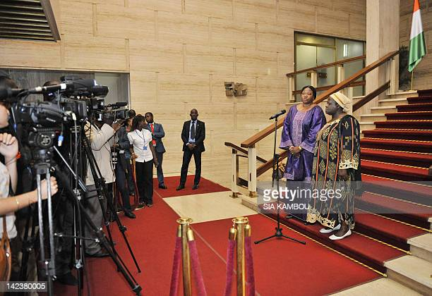 Gambianborn Fatou Bensouda the new chief prosecutor of the International Criminal Court and Ivory Coast's justice delegate Mattoloma Cisse speak to...