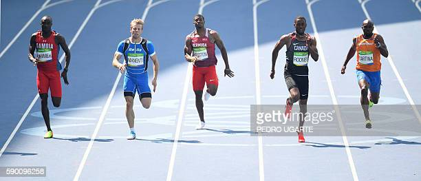 Gambia's Adama Jammeh Italy's Davide Manenti Bermuda's Harold Houston Canada's Brendon Rodney and Netherlands' Churandy Martina compete in the Men's...