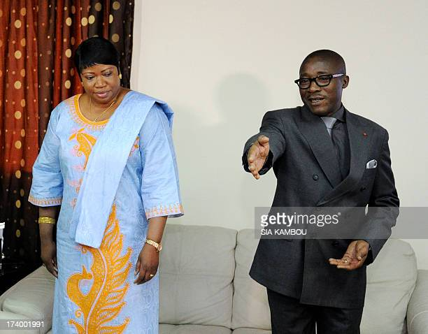 Gambia's Fatou Bensouda prosecutor at the International Criminal Court listens on July 19 2013 to Ivorian Justice minister Coulibaly Gnenema during...
