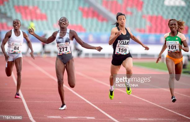 Gambia's Gina Bass crosses the finish line and wins the Women's 200m Final at the 12th edition of the African Games in Rabat on August 30 2019
