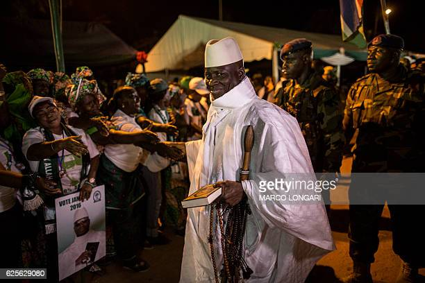 Gambia's incumbent President Yahya Jammeh , leader of the APRC , smiles while being greeted by supporters as he arrives at a campaign rally in...