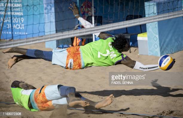 Gambia's Jawo vies for the ball during the men's final beach volleyball at the beach of Sale in Morocco during the 12th edition of the African Games...