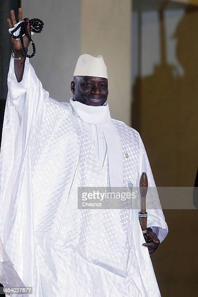 Gambia's President Yahya Jammeh arrives for a diner at the Elysee presidential palace in Paris as part of the Elysee summit for peace and safety in...