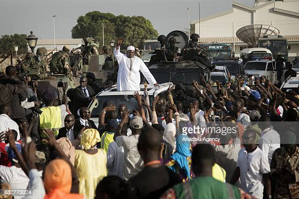 Gambia's president-elect Adama Barrow waves his supporters as he arrives his country from Senegal after the departure of former president of Gambia,...