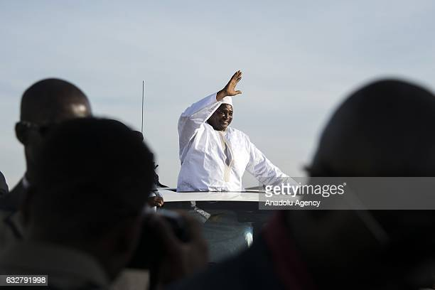 Gambia's presidentelect Adama Barrow waves his supporters as he arrives his country from Senegal after the departure of former president of Gambia...