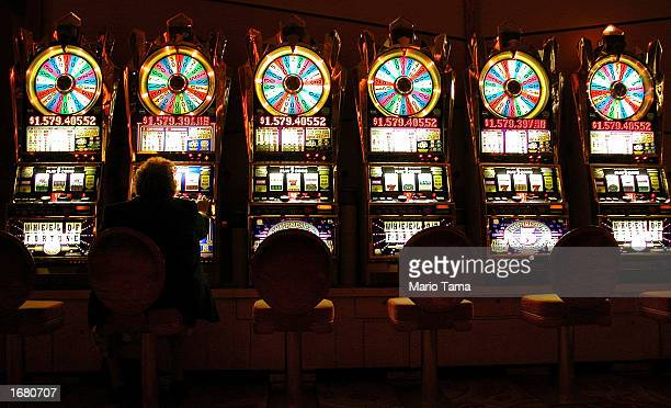 A gambler plays on some of the more than 6000 slot machines at Mohegan Sun casino November 20 2002 in Uncasville Connecticut The casino is owned and...
