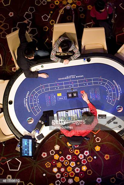 Gamblers play Baccarat in City of dreams casino on December 17 2009 in Macao China