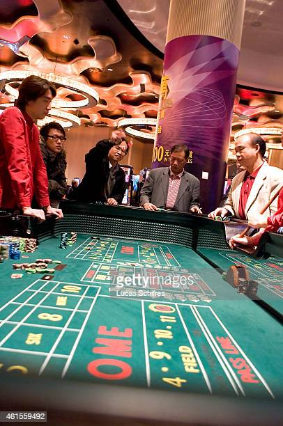 Gamblers play craps in City of dreams casino on December 17 2009 in Macao China