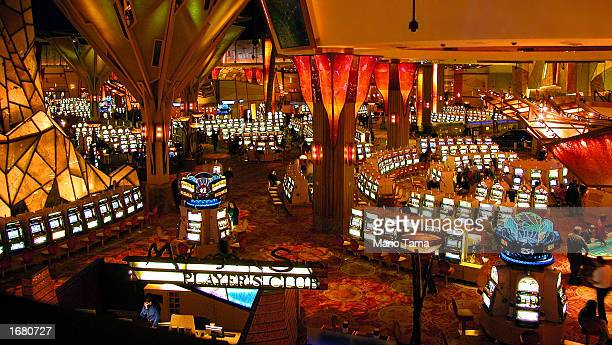 Gamblers play on some of the more than 6000 slot machines at Mohegan Sun casino November 20 2002 in Uncasville Connecticut The casino is owned and...