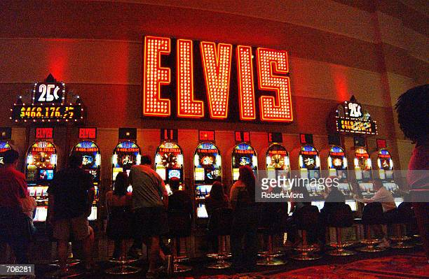 Gamblers play the Elvis slot machines at the MGM Grand Hotel and Casino on May 30 2002 in Las Vegas Nevada