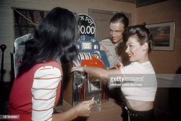 Gamblers play the Slots at the El Rancho Vegas hotel and casino in July 1942 in Las Vegas Nevada