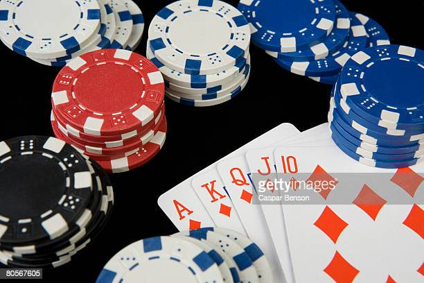 gambling chips and playing cards - hand of cards stock photos and pictures