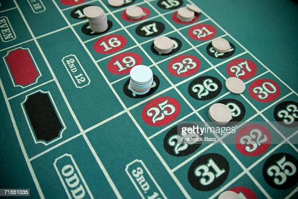 gambling chips on a roulette table - roulette stock pictures, royalty-free photos & images