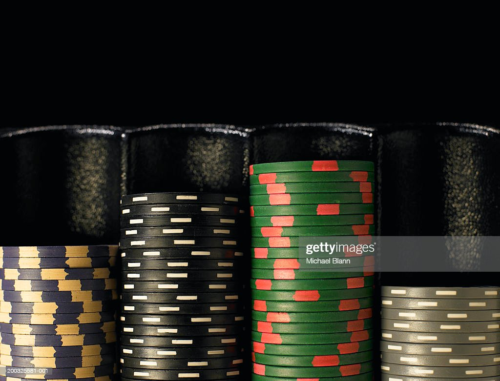 Gambling chips stacked in dispenser, close-up : Stock Photo