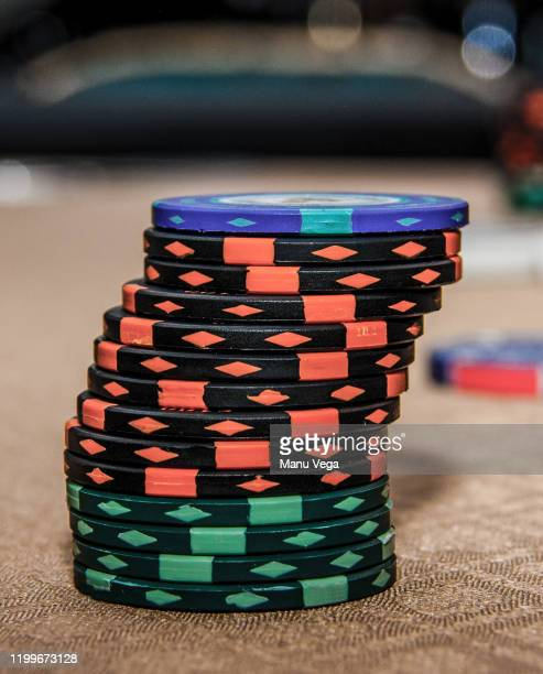 gambling chips stacked on roulette table in casino, close-up - stock photo - gambling table stock pictures, royalty-free photos & images