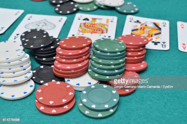 Gambling Chips With Cards On Table