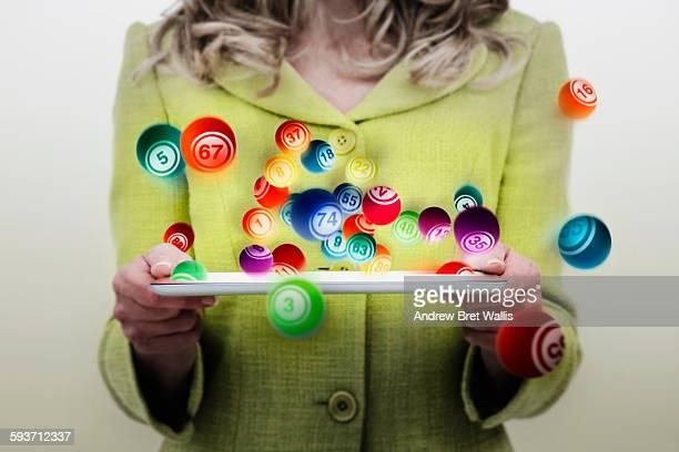 Gambling Concept of woman playing bingo on-line