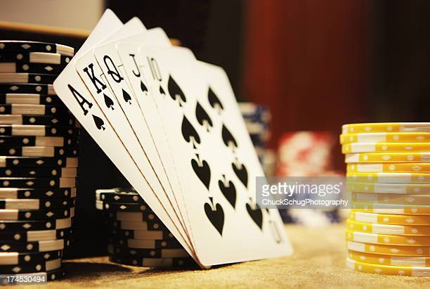 gambling poker hand royal flush spades - hand of cards stock photos and pictures