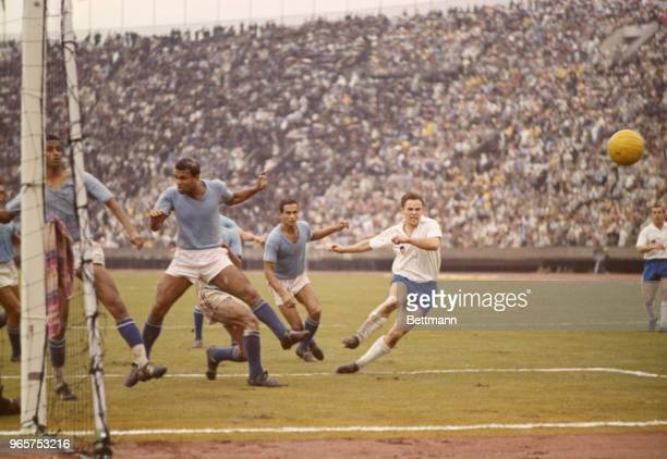 Game action during the soccer finals. Germany, in white shirts, won third place in the event and United Arab Republic, wearing blue shirts, placed...