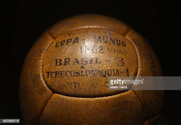 A game ball from Brazil's 1962 World Cup victory over Czechoslovakia is displayed in the Museum of Football on June 10 2014 in Sao Paulo Brazil The...