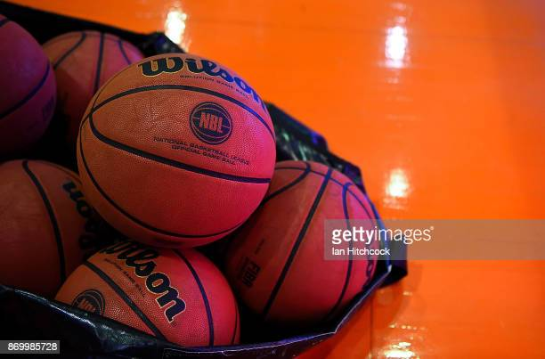 Game balls are seen on the court before the start of the round five NBL match between the Cairns Taipans and the New Zealand Breakers at Cairns...