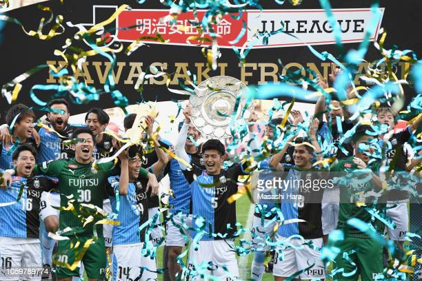 Game captain Shogo Taniguchi of Kawasaki Frontale lifts the JLeague Champions Schale as they celebrate the J1 Season Champions after the JLeague J1...