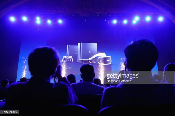 Game enthusiasts and industry personnel attend the Sony Playstation E3 conference at the Shrine Auditorium on June 12 2017 in Los Angeles California...