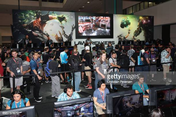Game enthusiasts and industry personnel compete in 'LawBreakers' during the Electronic Entertainment Expo E3 at the Los Angeles Convention Center on...