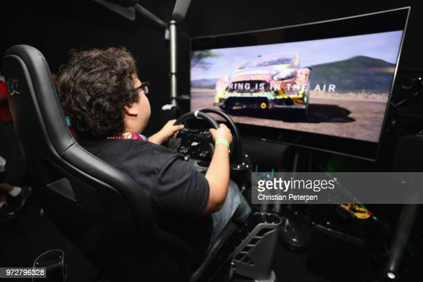 Game enthusiasts and industry personnel play 'Forza Horizon 4' during the Electronic Entertainment Expo E3 at the Microsoft Theater on June 12, 2018...