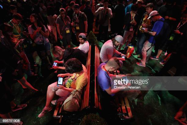 Game enthusiasts and industry personnel play the Switch in the Nintendo exhibit during the Electronic Entertainment Expo E3 at the Los Angeles...