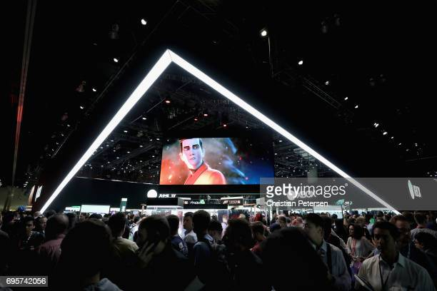 Game enthusiasts and industry personnel visit the Microsoft XBox exhibit during the Electronic Entertainment Expo E3 at the Los Angeles Convention...