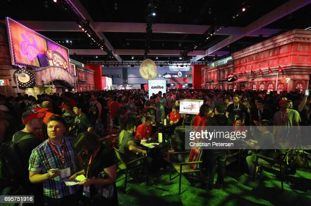 Game enthusiasts and industry personnel visit the Nintendo exhibit during the Electronic Entertainment Expo E3 at the Los Angeles Convention Center...